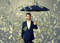 Smiley and glad man under money rain businessman with umbrella standing Royalty Free Stock Photos