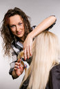 Smiley hairdresser working with client Royalty Free Stock Images