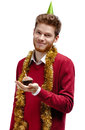 Smiley man with tinsel holds small cake Royalty Free Stock Photos