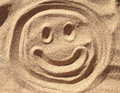 Smiley sand face drawn in beautiful Stock Photography