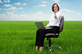 Smiley secretary on the field showing thumbs up Royalty Free Stock Image