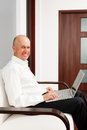 Smiley senior businessman working Stock Photos