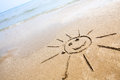 Smiley sun on the beach drawing sand perfect for greeting cards positive and happiness concept Stock Photography