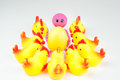 Smiley toy with egg and chickens holding a yellow surrounded by easter concept Stock Images