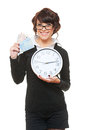 Smiley woman with clock and money Royalty Free Stock Photography