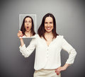 Smiley woman hiding her amazement Royalty Free Stock Photo