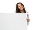 Smiley woman holding copyspace half length portrait of isolated on white Royalty Free Stock Image