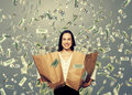 Smiley woman holding two paper bags alluring businesswoman with money under dollar s rain Stock Photos