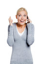 Smiley woman speaking phone her fingers crossed isolated white Royalty Free Stock Images