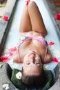 Smiley woman taking pleasure in milk bath Royalty Free Stock Photo