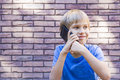 Smilig child talking on cell phone People, technology and communication concept. Royalty Free Stock Photo