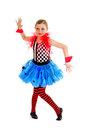 Smiling abstract circus jester performer preteen girl as a in a crooked stance Royalty Free Stock Images