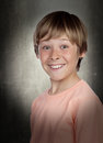 Smiling adolescent with a happy gesture on gray background Royalty Free Stock Photo