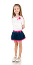 Smiling adorable little girl in skirt isolated