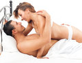 Smiling adult couple having sex on bed in bedroom interior at home Royalty Free Stock Images
