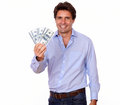 Smiling adult man holding cash dollars portrait of a on white background Royalty Free Stock Photo