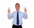 Smiling adult man showing you victory sign portrait of a on isolated background Stock Photos