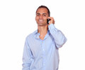 Smiling adult man speaking on cellphone Royalty Free Stock Photo