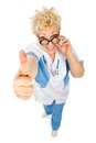 Smiling adult woman medical suit shows thumb up camera holds glasses white background Royalty Free Stock Photo