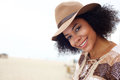 Smiling african american fashion woman with hat Royalty Free Stock Photo