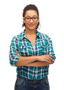 Smiling african american girl in eyeglasses hapiness and people concept young woman with crossed arms Stock Image