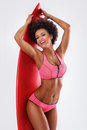 Smiling african american girl with surfboard. Royalty Free Stock Photo