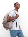 Smiling african american male college student walking Royalty Free Stock Photo