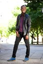 Smiling african american man in black leather jacket Royalty Free Stock Photo