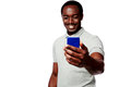 Smiling african man using smartphone Royalty Free Stock Photo
