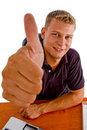Smiling american male showing good luck sign Royalty Free Stock Photography