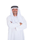 Smiling arabian man standing arms crossed over white background portrait of Royalty Free Stock Photo