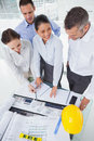 Smiling architect team working together in bright office Stock Photos