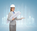 Smiling architect in white helmet with blueprints building developing consrtuction and architecture concept showing something on Stock Photos