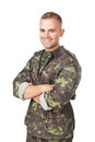 Smiling army soldier with his arms crossed isolated on white background Stock Images