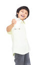 Smiling asian boy with a glass of milk Royalty Free Stock Photography