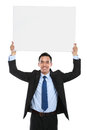 Smiling asian business man holding empty board ready for your design Stock Image