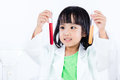 Smiling Asian Chinese Little Girl Examining Test Tube With Unifo Royalty Free Stock Photo