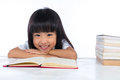 Smiling Asian Chinese little girl reading book Royalty Free Stock Photo
