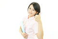 Smiling asian female nurse with thumbs up portrait of an Stock Images