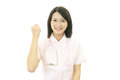 Smiling asian female nurse the who poses happily Stock Photo