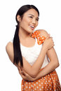Smiling Asian girl in a polka dot dress Royalty Free Stock Photos