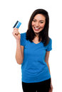 Smiling asian girl showing cash card young pretty her credit to the camera Stock Image