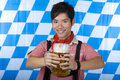 Smiling Asian holding Oktoberfest Royalty Free Stock Image