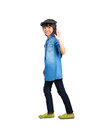 Smiling asian little girl in the action of walking isolated over white with clipping path Royalty Free Stock Photo