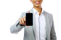 Smiling asian man holding smartphone over white background focus on Royalty Free Stock Photography