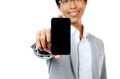 Smiling asian man holding smartphone over white background focus on Stock Photography