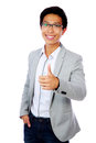 Smiling asian man showing thumb up portrait of a isolated on a white background Stock Image