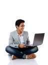 SMiling asian man sitting on the floor Royalty Free Stock Photo