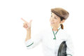 Smiling asian waitress pointing on white background Stock Images