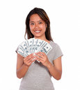 Smiling asiatic young woman with cash money portrait of a looking at you on isolated background Royalty Free Stock Photography